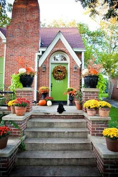 too much colour the planters. green or white better: Green door with red brick + fall porch. Love the lime green color. I have been looking for a accent color for our brick house! Purple Front Doors, Front Door Colors, Painted Exterior Doors, Exterior Paint, Pintura Exterior, Red Bricks, Cool House Designs, Exterior Colors, Porch Decorating