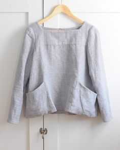 This is a neat shirt. I like how the material looks and that it looks like it'd be a looser, boxy fit. I prefer a lower neckline, though