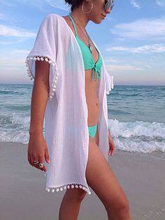 He encontrado este interesante anuncio de Etsy en https://www.etsy.com/es/listing/229693472/beach-cover-up-coverup-with-pom-poms