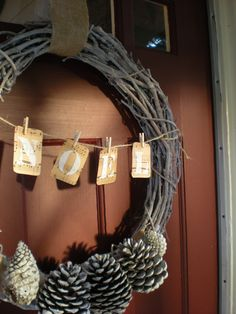 twine with clothespins holding letters across the middle.  Can't decide if I like the pinecones... I do like that they are spray-painted monochromatically