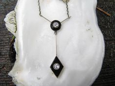 Wonderful Art Deco 14K White Gold Onyx and Old Mine Cut Diamond Necklace - Classic Deco Style. $422.00, via Etsy.