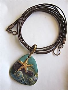 Necklace by Lynn Carling with Clayworks stoneware starfish wave pendant.