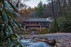A house built NOT by a creek, but actually over a creek!!!     Platt Architecture designed the Knob Creek Residence located in the forests of Cashiers, North Carolina.