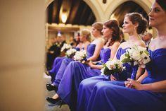 chic violet bridesmaids dresses with elegant white bouquets.