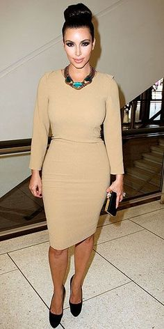 In town to watch her little sis walk the runway, the newlywed is pretty and polished in her bracelet-length Rachel Roy camel sheath, black accessories and striking statement necklace en route to the Roy's presentation.... - Kim Kardashian Style