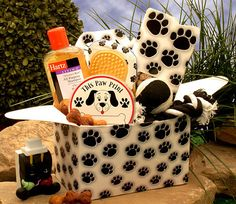 """Another pinner wrote, """"This Gift Basket for Dogs is a fantastic way to spoil the dog in your life or their owner's with a fun and imaginative pet care package designed specifically for the dog lover. An adorable dog paw print gift box, loaded with toys and treats. Doggie Shampoo, Doggie Ball, Doggie Chew Toy, Doggie washing mitt/ or brush, beef flavored dog bones."""""""