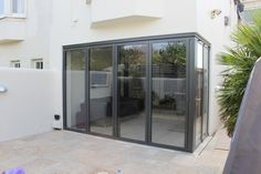 Image result for are wrap around bi folding doors expensive