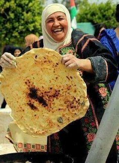 A golden smile with beautiful bread from Palestine