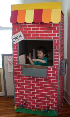 Refrigerator Box and Bulletin Board Paper into a play store - AWESOME! Cardboard Box Crafts, Cardboard Playhouse, Cardboard Castle, Paper Crafts, Toddler Fun, Toddler Activities, Kids Church Decor, Homemade Toys, Thinking Outside The Box