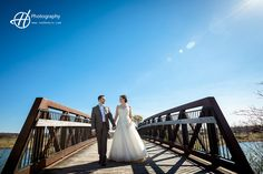 The bridge is a great addition to wedding photos anytime. Amanda and Tony's wedding. Photo by Clauda Halip for H Photography