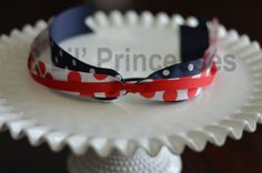 Perfect for the 4th of July or to wear in support of your favorite team! This beautiful red, white and blue pony-o compliments any ponytail, fits well under helmets, and makes sliding a baseball hat on and off a breeze! Each pony-o is made with high quality grosgrain ribbon with heat sealed ends.