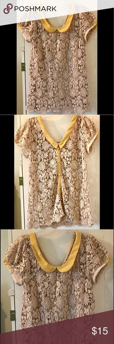 """Pretty!! Crochet Blouse By Esley M Re-Posh in Great Condition, did not work with my coloring. Beige Crochet Blouse with a mustard-colored poly.-silk Placket & 6 Buttons down the back! They are for decor~do Not unbutton. Collar is Lovely & Unique. Authentic, Actual Crochet!! See-through, But, a beige Cami, with Straps stitched inside to a snap! A Medium, the Shoulders-seam-to-seam, across measure: 15.5""""  Length: 26"""" from Collar to Hem & Bust is 17-17.5"""" across. tops of sleeves are trimmed in…"""