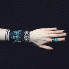 This blackwork by Sasha Masiuk can easily be completed with real jewelry for an edgy style.