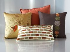 You'll love the color scheme and bold decorative touches the Mallory pillow pack brings into a room.