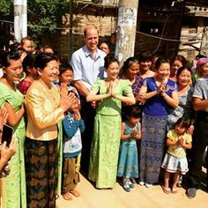 Welcoming villagers stand with The Duke of Cambridge for a photograph during his visit to a Dai village in Xishuangbanna, China #RoyalVisitChina