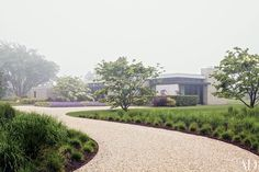 A Bridgehampton, New York, house nestles into serene gardens by Gunn Landscape Architecture.