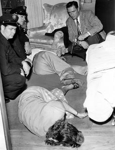 Murder-Suicide Scene July 23, 1948 Friday Bodies of Alvin Roberts and his wife, Maxine, lie in friend's Hollywood apartment after Roberts pumped three bullets into wife's body, then shot himself through head. Dual tragedy followed family quarrel.
