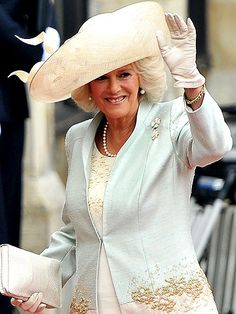 DUCHESS OF CORNWALLThe stepmother of the groom complements her Anna Valentine champagne dress and two-tone coat with an airy Philip Treacy hat, one of up to 100 he's made for guests at the ceremony and parties.