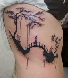 Back #tattoo of #girl on a #bridge. This one is so powerful in just black ink.