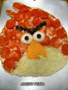 Angry Birds pizza. Send this to Marks FB account and tell him to buy a wooden pizza peel with a handle and he can make this on the grill. I tried to do it. Did not work.