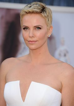 Achieve Charlize Theron's boyish glamor by parting your hair to the side and pushing up the front portion, then applying wax to maintain hold.  - GoodHousekeeping.com