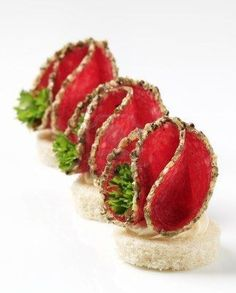 Picture of Spice coated salami canapes - studio shot stock photo, images and stock photography. Gourmet Recipes, Appetizer Recipes, Gourmet Desserts, Sushi Recipes, Gourmet Foods, Plated Desserts, Snacks Für Party, Food Decoration, Appetisers