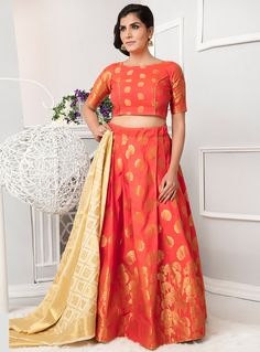 Fashion and trend will be on the peak of your attractiveness when you attire this orange art silk lehenga choli. This pretty dress is displaying some extraordinary embroidery done with weaving work.Largest selection of lehenga choli from popular indi Indian Lehenga, Silk Lehenga, Orange Lehenga, Choli Designs, Blouse Designs, Lehenga Choli Online, Half Saree, Indian Ethnic Wear, Indian Outfits