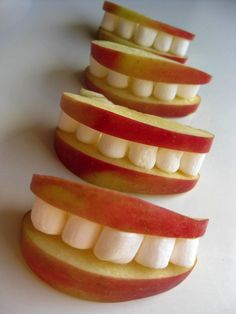 Apple slices, mini-marshmallows, honey (or peanut butter): Smile for camera. (source)