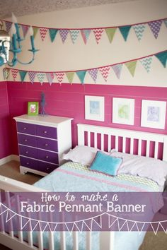 Fabric Pennant Banner 30 Feet Long - used to decorate a girl's bedroom wall | KristenDuke.com