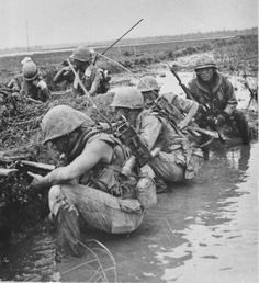 """Photo taken Sept. 7th, 1969 - """"Elements of the 26th Marines under fire south of Da Nang, 3 RTO's in the same spot.. I am guessing that the photo is of the company CO and his radio operator, a FO calling in artillery with his RTO, and the 3rd would be a squad RTO which is there to protect the FO and Skipper."""" ~ Vietnam War"""