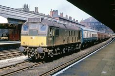 BR Sulzer AEI Type 2 Bo-Bo D5154 runs through Bolton Trinity Street station with a train of empty coaching stock. 14th June 1968 (Bill Wright)
