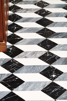 This honed-marble floor was made from tiles that were cut into rhomboids and squares and reassembled to trick the eye. | Photo: Deborah Whitlaw Llewellyn | thisoldhouse.com