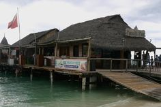 The Pelican's Nest restaurant is located on the pier on the beach (located between the Holiday Inn and the Playa Linda Beach Resort.)