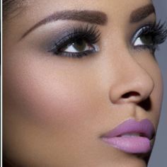Man, I love, love, LOVE her eyebrows! And I'm gonna find me a shade of purple lipstick like hers