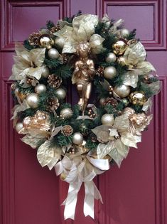 CHRISTMAS IS LOVE. Cherub Wreath with Gold Poinsettias, Ornaments, Pine Cones, Champagne Bow. Elegant Christmas, Luxurious Holiday Wreath.