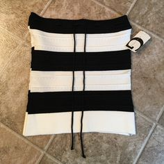 Black and white strapless top Classic and chic sweater-like material. NWT. Very stretchy material to flatter every figure and at the top of the chest area has a drawstring design you can tie in a knot or bow. Perfect condition. Brand new. Make a reasonable offer. Thanks for looking ☺️ Tops