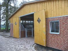 Modern German stable barn with brick and timber finish. http://www.allemann-gmbh.de