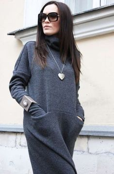 Long Winter sweater dress in gray. I like the heart pendant necklace but the weird square bracelet is not my favorite. Muslim Fashion, Modest Fashion, Hijab Fashion, Boho Fashion, Winter Fashion, Fashion Dresses, Fashion Looks, Womens Fashion, Fashion Trends