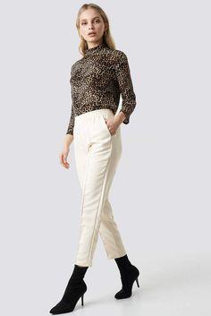 a18ea7b3d6cb The Elastic Waist Seamline Pants by NA-KD Urban features a high elastic  waist