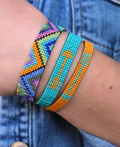 Colorful hand loomed beaded bracelet with a unique geometric pattern. Each takes… Colorful hand loomed beaded bracelet with a unique geometric pattern. Each takes hours to make by hand. Unique artisan jewelry by Ever Designs Jewelry. Bead Loom Patterns, Jewelry Patterns, Beading Patterns, Beading Ideas, Beading Supplies, Bead Loom Designs, Loom Bracelet Patterns, Embroidery Bracelets, Bead Loom Bracelets