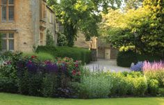 Lords of the Manor garden Upper Slaughter UK via twirling betty