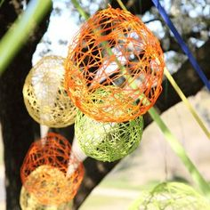 Thought you could take strands of the icicle Christmas lights and put some inside the globes (but have more yarn wrapped around the balloon) to make a neat decoration for an outdoor party.