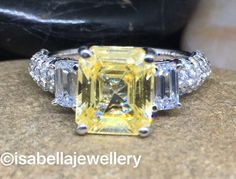 8.00ct Emerald cut three stone ring .925 sterling silver AAAAA grade cubic zirconia yellow and white