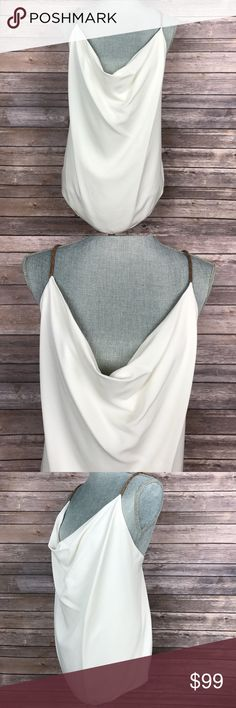 {Yigal Azrouel} Color Block Braided Strap Blouse Pullover. Drape neckline. Sleeveless. Cries-cross back. Self: 100% Silk. Trim: 100% leather. Condition: New without tags. Yigal Azrouel Tops Blouses