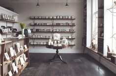 simple display at Rifle Paper Co. shop | via Sous Style