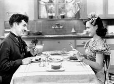 Still of Charles Chaplin and Paulette Goddard in Modern Times