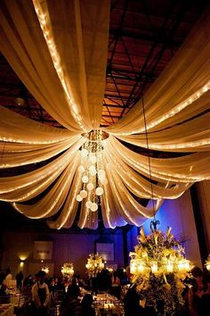 It would be cool to do a chandelier in the middle with the tulle and lights coming off of it!