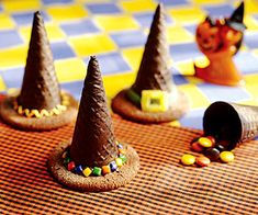Fill ice cream cones with candy treats before attaching them to their cookie bases to make these sweet Halloween treats.