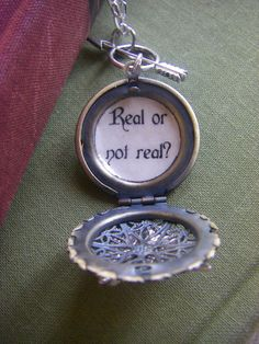 Hunger Games Real or Not Real Locket Mockingjay Arrow  Gift for her READY TO SHIP. $24.00, via Etsy.