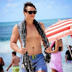 Black turkish towel being sported by Tom from Inspired 2 Give